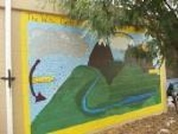 Photo of a mural on the wall in the SESS garden